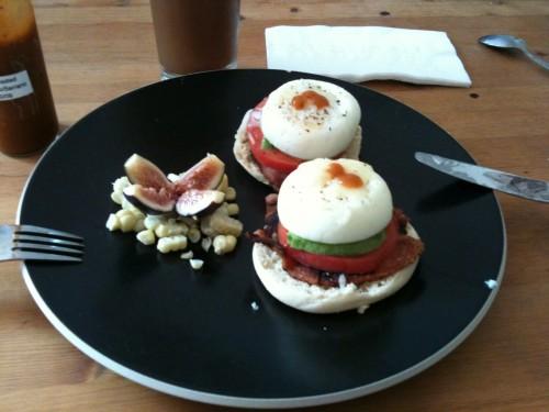 poached eggs with tomato, avocado, bacon, mozzarella and hot sauce